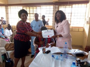 Presentation of Certificate to participants during the 2019 workshop of the Institute of Education